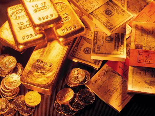 слитки золота фунты доллары